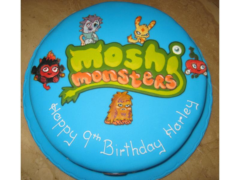 "A 10"" round Madeira sponge cake, based on the cartoon characters Moshi Monsters for Harley of Bispham"