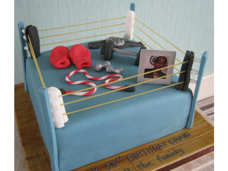 Craig in Blackpool 33rd birthday in chocolate sponge showing interests in boxing and fitness