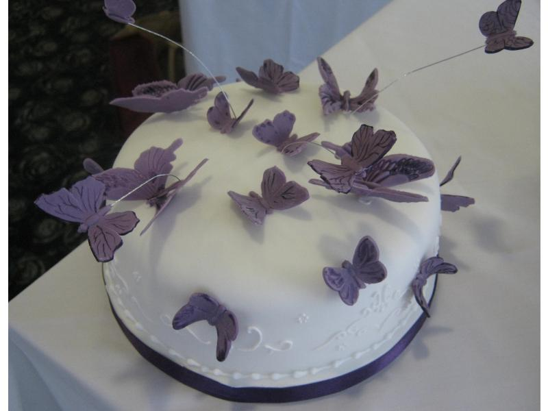 Cake with butterflies for Cadbury-themed wedding of Hayley at Ribby Hall and from Lytham in Madeira