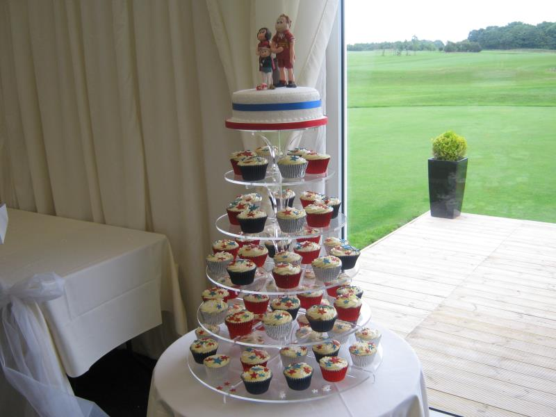 Red, white & blue themed wedding cupcakes for Laura in Staining from Madeira sponge with personalised figures