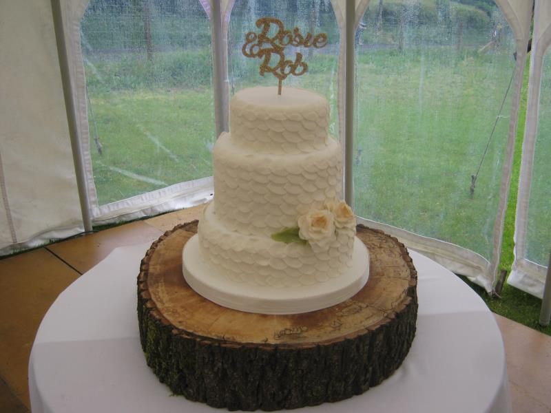Leaves in white for Rosie & Rob's wedding in Derbyshire from fruit cake.Decorated in white sugarpaste leaves