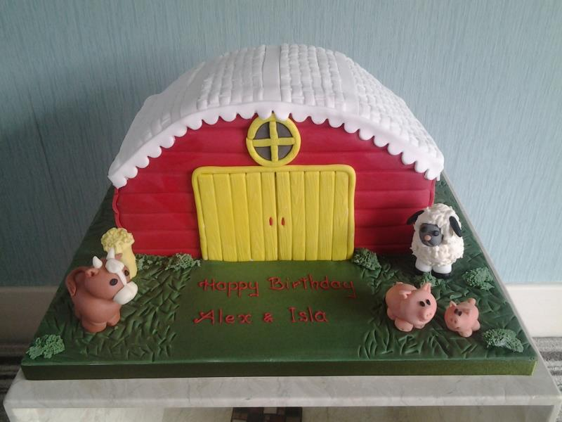 Red Barn with farmyard animals in chocolate sponge for a joint birthday in Preston