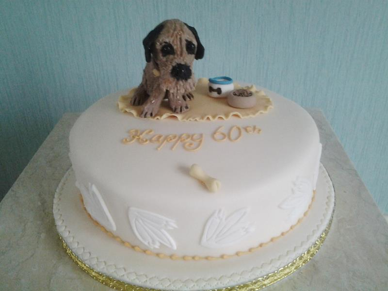 Buddy - Kath's pet dog Buddy on Kath's birthday cake in plain sponge for party at Center Parcs, Cumbria