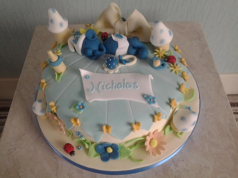 Sleeping Smurf for Nicholas' first birthday in Blackpool, made from chocolate with orange sponge.