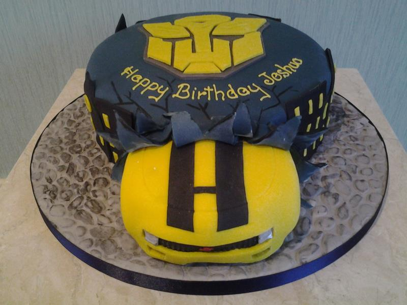 Transformer's logo with car breaking out birthday cake in chocolate sponge for Joshua in South Shore, Blackpool