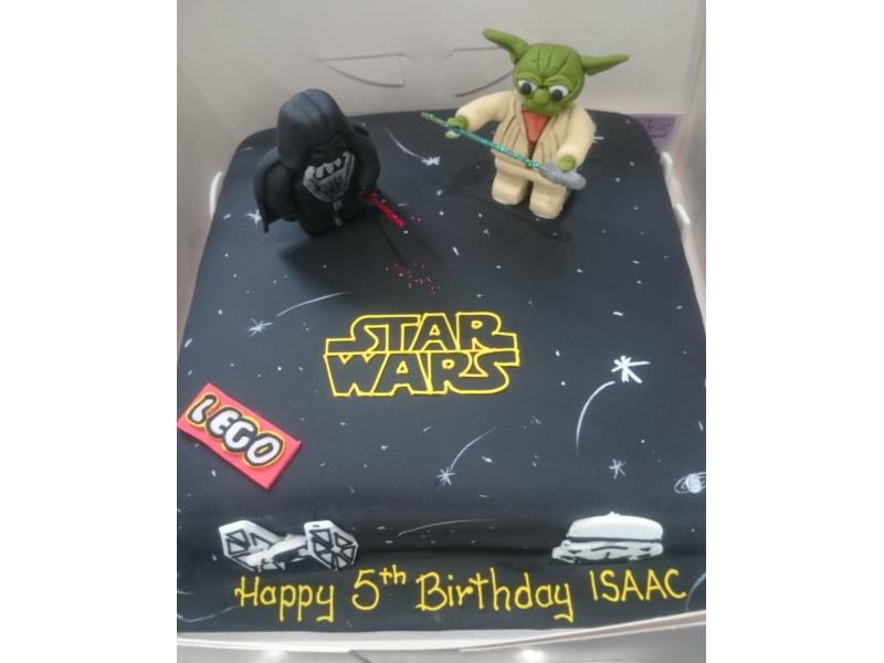Star Wars themed cake with Yoda, Stormtroopers and Darth Vader as well as Lego logo, made from chocolate sponge for Isaac in Lytham