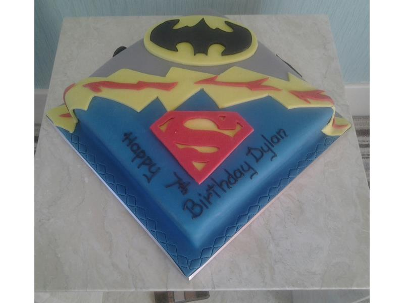 Batman Superman logos on Dylan's birthday cake made from chocolate sponge