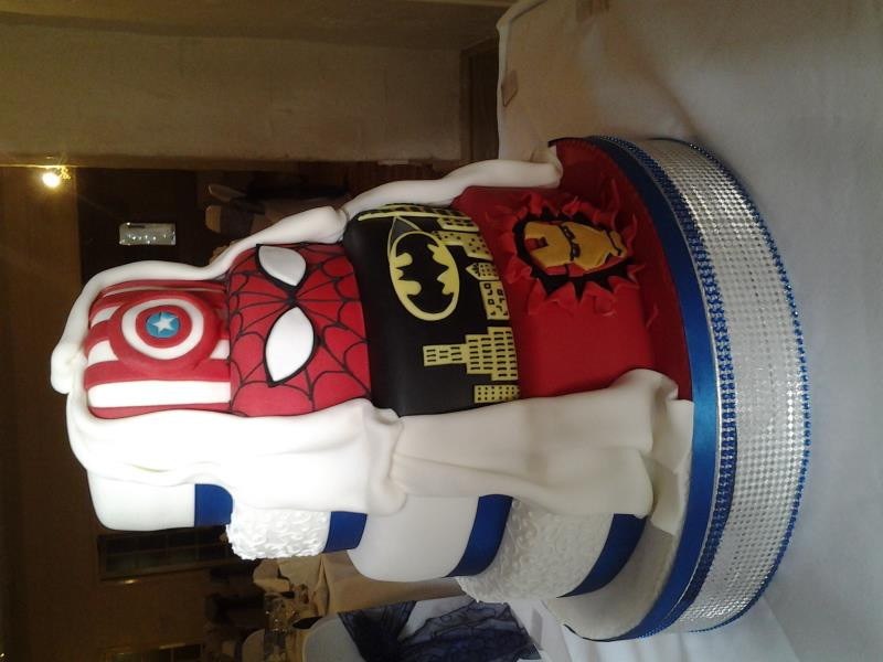 Marvel wedding cake with more traditional reverse view in 4 tiers of sponges
