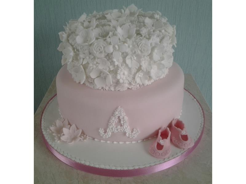 Laura  Chrsitening Cake in Madeira. 2 tiers in pink and white with flowers