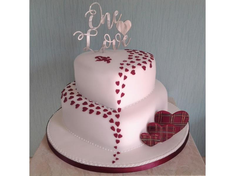 Tartan and hearts 2 tier wedding cake for Fiona & Becky from Eccles, married in Blackpool. Made from fruit cake and vanilla sponge