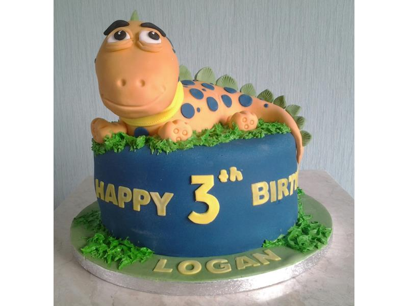 Friendly dinosaur cake for Logan in Blackpool, made from vanilla sponge
