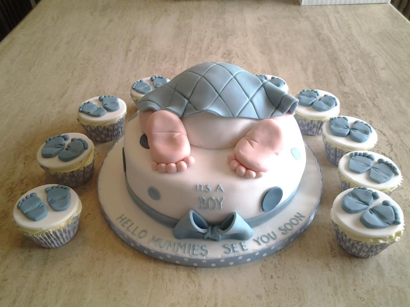 Stefi - baby shower cake in choclate with orange sponge and vanilla sponge cupcakes