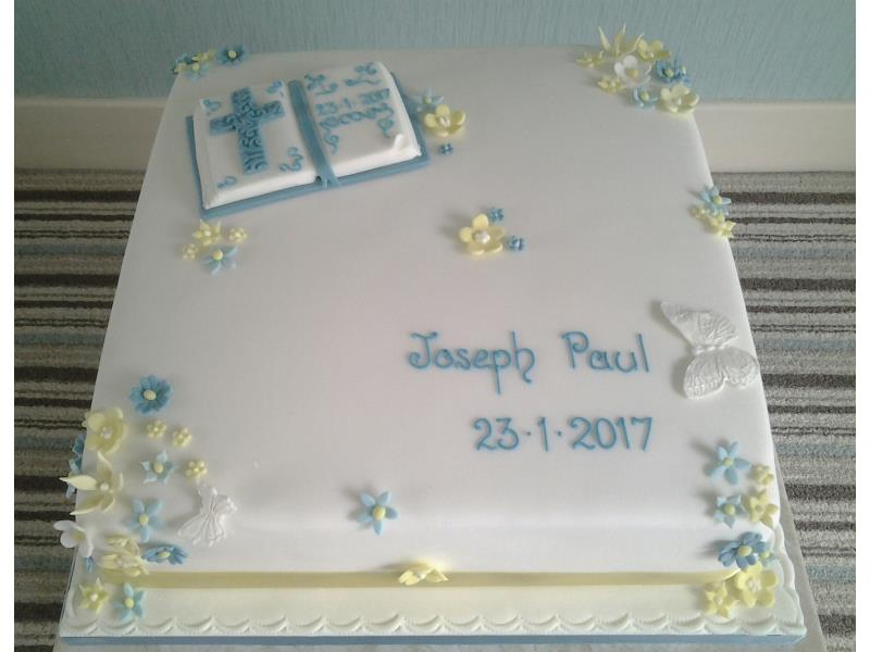 Boy's Christening Cake for Joseph paul in Bispham, with 2 tiers of vanilla sponge. decorated with bible and cross