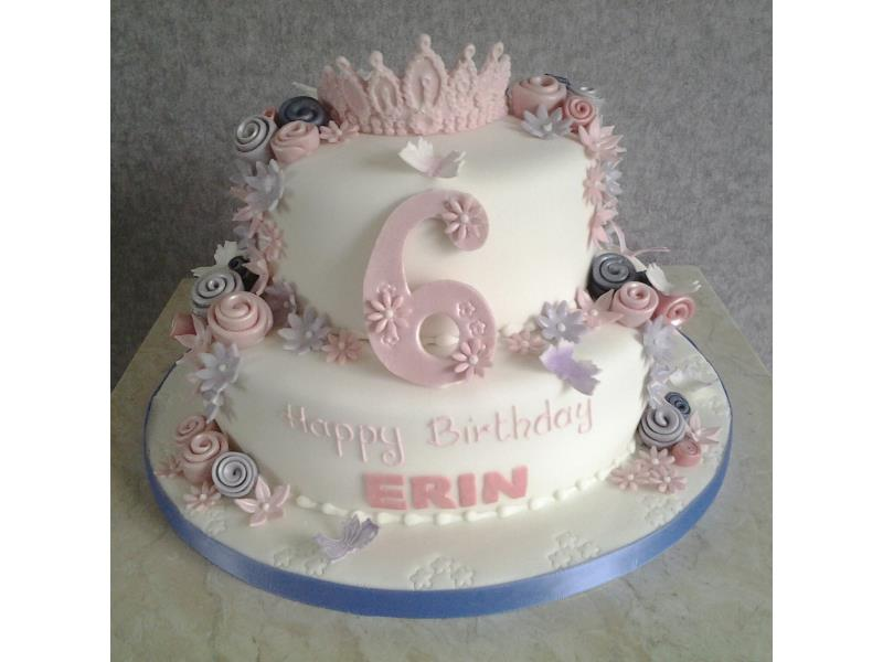 Pink Tiarra with roses in shades of pink on 2 tiers of chocolate sponge for Erin's 6th birthday in Blackpool