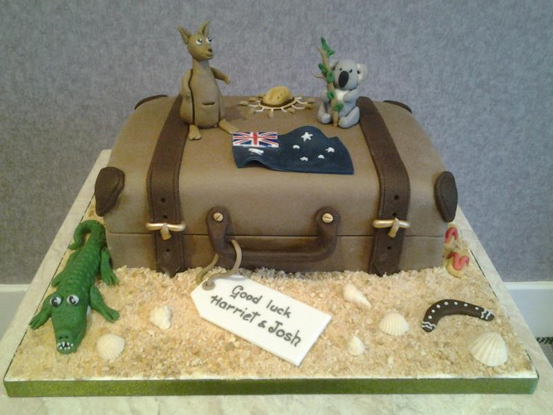 Emigrating - suitcase and Australia icons for Harriet & Josh in Blackpool. Made from chocolate with orange sponge