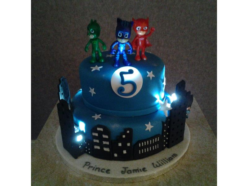 2 Tier PJ Masks with lights for Jamie in Cleveleys. Made with chocolate sponge