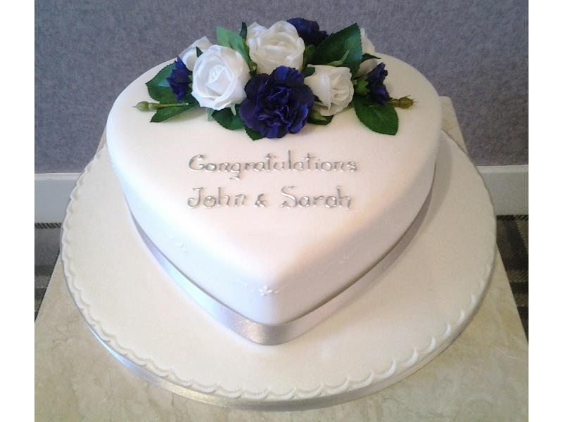 Heart - classy and simple heart shaped wedding cake for John and Sarah in South Shore. Made from vanilla sponge.