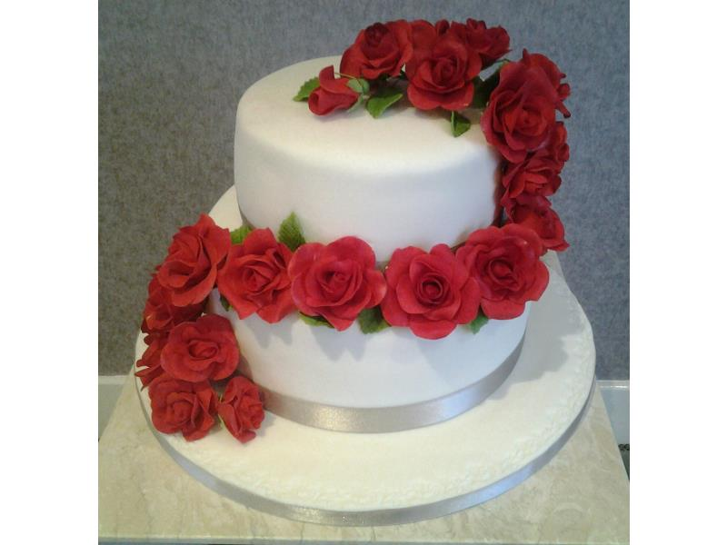 Cascading Roses design with hand modelled roses and chocolate and vanilla sponges. Made for Sam's wedding in Blackpool.