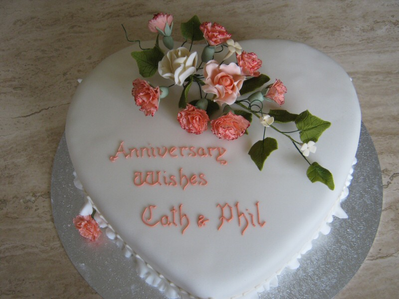 Phil and Cath - Peach carnations on a heart shaped cake for Phil and Cath's wedding anniversary