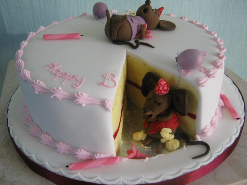 Mice Eating Cake - Yes, really! The mice have eaten a slice of this lovely birthday cake.